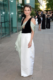 Keri Russell looked fancy in a tricolor gown by Rosie Assoulin, featuring a plunging neckline and a drapey accent, during the CFDA Fashion Awards.