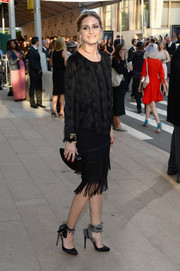 A fringed black pencil skirt by Ann Taylor added some '20s flair to Olivia Palermo's look.