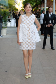 Marion Cotillard paired her dress with pale-yellow Dior pumps with white diagonal straps.
