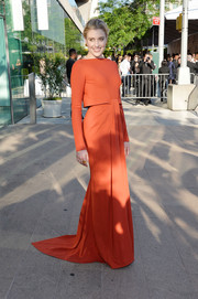 Greta Gerwig looked very classy at the CFDA Fashion Awards in a rust-colored Zac Posen gown featuring a cropped overlay and a floor-sweeping train.
