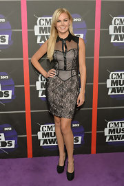 Laura Bell Bundy chose this black lace corset dress with a leather point collar for the CMT Music Awards.