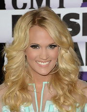 To avoid an over-the-top beauty look, Carrie Underwood chose a muted nude lipstick.