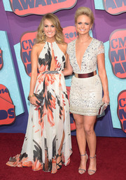 Carrie Underwood was summer-glam at the CMT Music Awards in a Roberto Cavalli print dress with a keyhole neckline and an up-to-there slit.