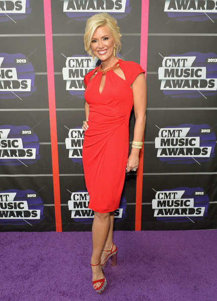 Allison Demarcus wore this ruched cutout dress in a vibrant crimson color.