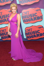 Kellie Pickler's purple Lorena Sarbu gown at the CMT Music Awards was a sight to behold with its plunging neckline, side cutouts, and flowing train.