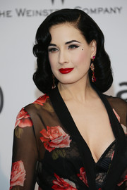 Dita Von Teese's red lipstick looked striking against her fair complexion.