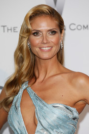 Heidi Klum attended the Cinema Against AIDS Gala wearing a lovely wavy hairstyle.
