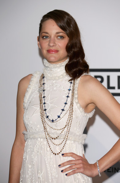 Marion Cotillard styled her white dress with layers of Chopard gemstone necklaces for the Cinema Against AIDS Gala.