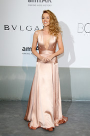 Kylie Minogue looked ageless wearing a nude Juan Carlos Obando gown with a navel-grazing neckline during the Cinema Against AIDS Gala.