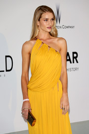 Rosie Huntington-Whiteley paired a glittery Jimmy Choo clutch with a fabulous one-shoulder dress for the Cinema Against AIDS Gala.