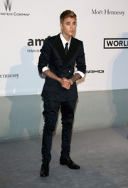 Justin Bieber wowed in a midnight-blue suit by Dolce & Gabbana at the 2014 amfAR Cinema Against AIDS Gala.