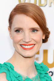Jessica Chastain's bright orange lipstick made a lovely contrast to her green gown.