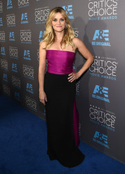 Reece Witherspoon arrived at the Critics' Choice Movie Awards in a lovely gown that popped with a bright fuchsia bodice and ruffled train.