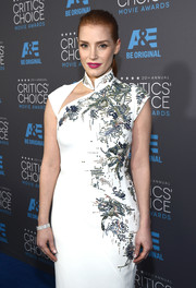Jessica Chastain got all dolled up with a stunning Piaget diamond watch and a beaded cheongsam for the Critics' Choice Movie Awards.