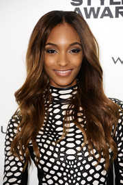 Jourdan Dunn attended the Elle Style Awards wearing a sexy center-parted wavy cut.