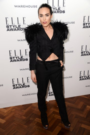 Tallulah Harlech was rocker-chic at the Elle Style Awards in a black Louis Vuitton cropped jacket with feather-embellished shoulders.
