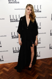 Cara Delevingne looked dramatic at the Elle Style Awards in a floor-sweeping robe-like black dress.