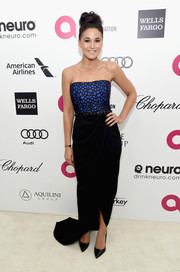 Emmanuelle Chriqui chose a Pamella, pamella roland strapless gown, featuring a patterned blue bodice and a black skirt, for Elton John's Oscar-viewing party.
