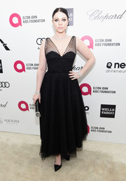 Michelle Trachtenberg looked captivating during Elton John's Oscar-viewing party in a Milly LBD with a sheer, dotted overlay.