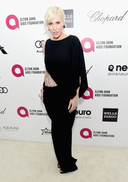 Natasha Bedingfield opted for an asymmetrical black gown with a cobweb-like side accent for Elton John's Oscar-viewing party.