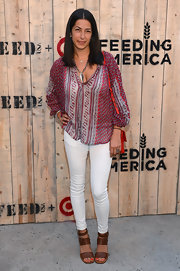 Rebecca Minkoff paired skinny white pants with a print tunic for a casual yet stylish finish at the Feed USA + Target launch.