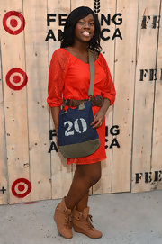 Denise Bestman contrasted her feminine dress with a pair of edgy lace-up wedge boots at the Feed USA + Target launch.