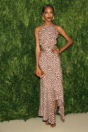 Jourdan Dunn paired her frock with an elegant mirrored gold clutch.