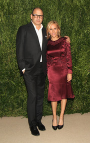 Tory Burch went for classic elegance in a long-sleeve burgundy cocktail dress during the Fashion Fund finalists party.