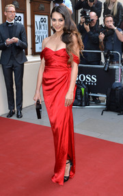 Zara Martin brought a touch of Old Hollywood glamour to the GQ Men of the Year Awards with this elegant red off-the-shoulder gown.