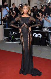 Jourdan Dunn looked sensual in a black Zuhair Murad Couture gown with multiple see-through mesh panels at the GQ Men of the Year Awards.