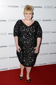 Rebel Wilson stepped out on the red carpet in this black lace frock.