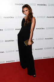 Victoria Beckham kept her look sleek and classic on the red carpet with this strapless wide-leg jumpsuit.