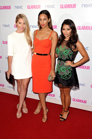 Mollie King styled her dress with a pair of nude crisscross-strap platform sandals, also by Louis Vuitton.