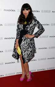 Jameela Jamil spiced up her look with this gray and black patterned coat.