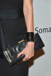 Petra Nemcova accessorized with an elegant black chain-strap bag at the Life is Love Gala.