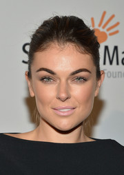 Serinda Swan didn't need much more than a ponytail and minimal makeup to look red carpet-ready at the Life is Love Gala.