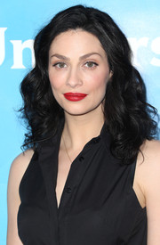 Joanne Kelly looked very feminine with her curly 'do and bold red lips during NBCUniversal's Summer Press Day.