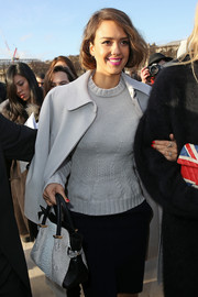 Jessica Alba made her way to the Nina Ricci fashion show carrying a very classy black-and-white python tote from the label.