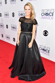 Brooke Anderson completed her red carpet look with a floor-sweeping black satin skirt.
