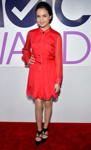 Bailee Madison went the conservative, classic route with this long-sleeve red Charles Henry shirtdress during the People's Choice Awards.