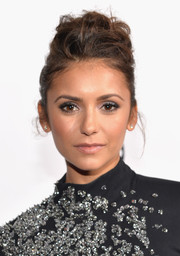 Nina Dobrev teased her hair into a messy-chic pompadour for the People's Choice Awards.