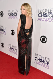 Desi Lydic went for sexy glamour at the People's Choice Awards in a fully sequined black gown with a draped open back and a high slit.