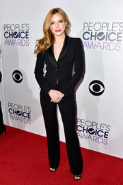 Bella Thorne stood out from a sea of gowns in her sleek black Giorgio Armani pantsuit during the People's Choice Awards.