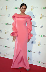 Madalina wore this soft pink gown that featured a bold ruffled neck, which lead into a stylish ruffled sleeve.