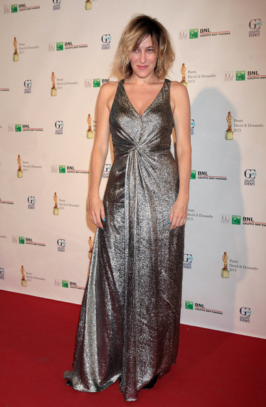 Valeria sparkled on the red carpet with this metallic silver gown.