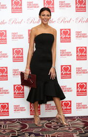 Michelle Keegan styled her dress with a pair of heavily embellished T-strap sandals.