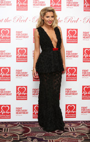 Mollie King was all about sexy glamour at the Roll Out the Red Ball in a textured black Sarah Baadarani peplum gown featuring a deep-V plunge and a sheer skirt.
