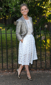 Emilia Fox added some dazzle to her look with a silver sequined jacket.