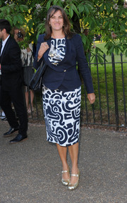 Tracey Emin looked smart in a navy tux jacket layered over a print dress during the Serpentine Gallery Summer Party.