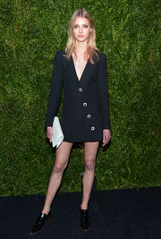 Sigrid Agren opted for a pair of black patent loafers to complete her look.